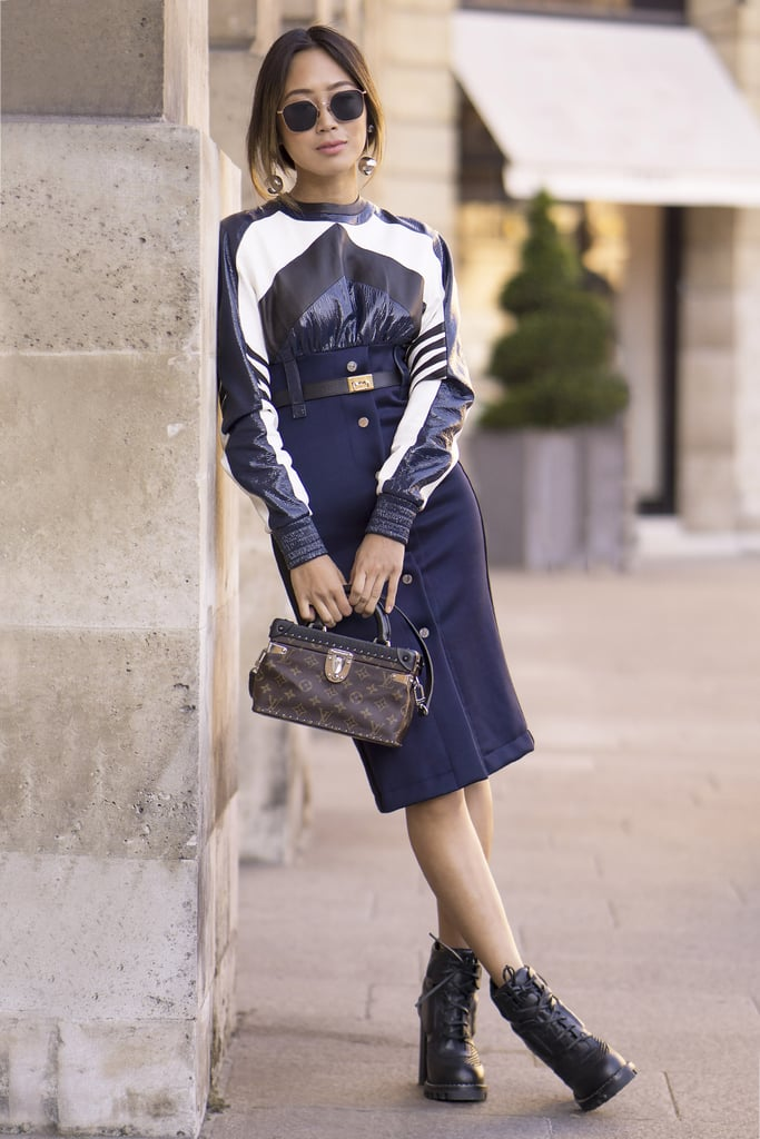 Aimee Song with a Louis Vuitton bag at Paris Fashion Week