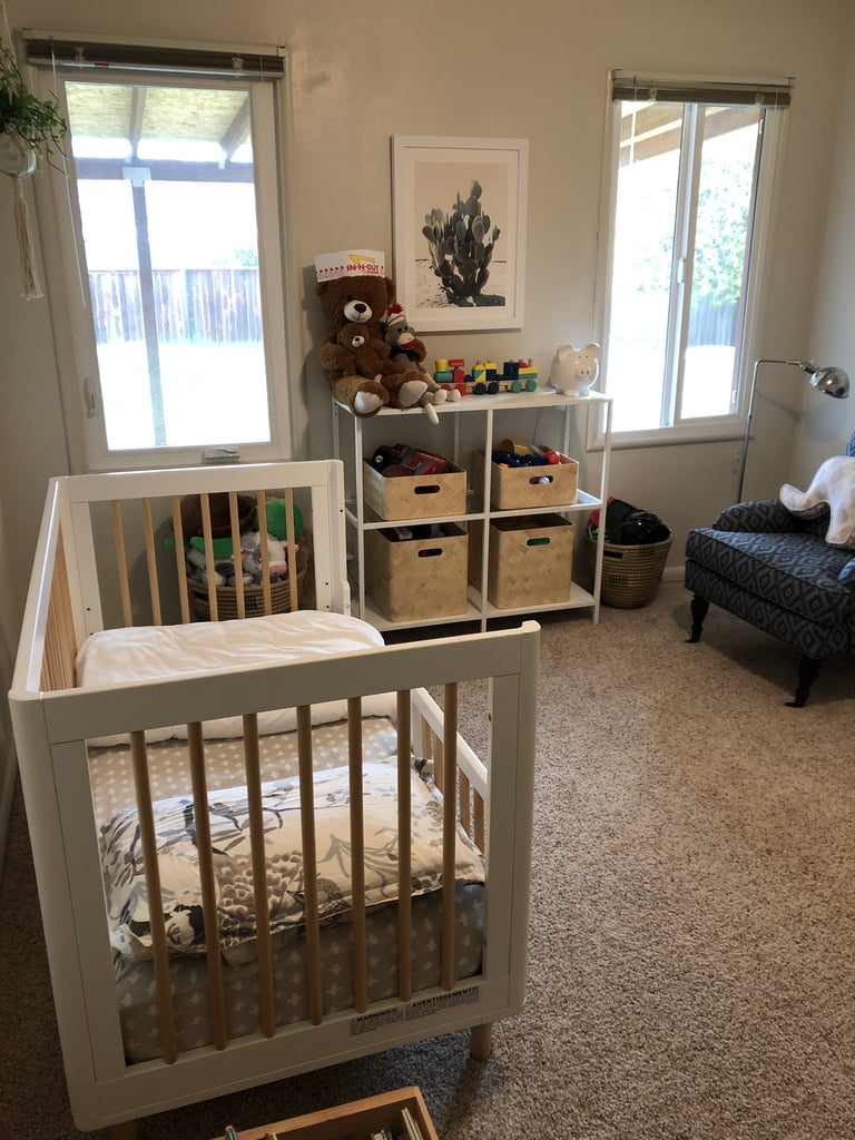We kept my son's toys stored in baskets on an Ikea shelf that fit between the two windows. Round baskets were placed on the floor beneath the windows to hold extra play things, like stuffed animals and costumes.