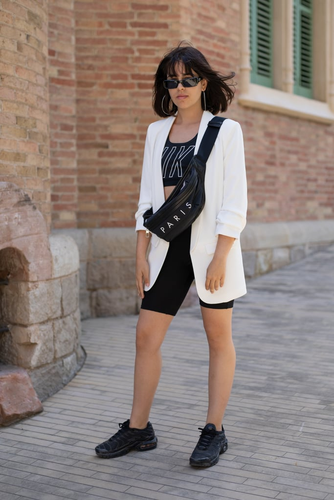 Style Your Sports Bra With a White Blazer and Black Biker Shorts