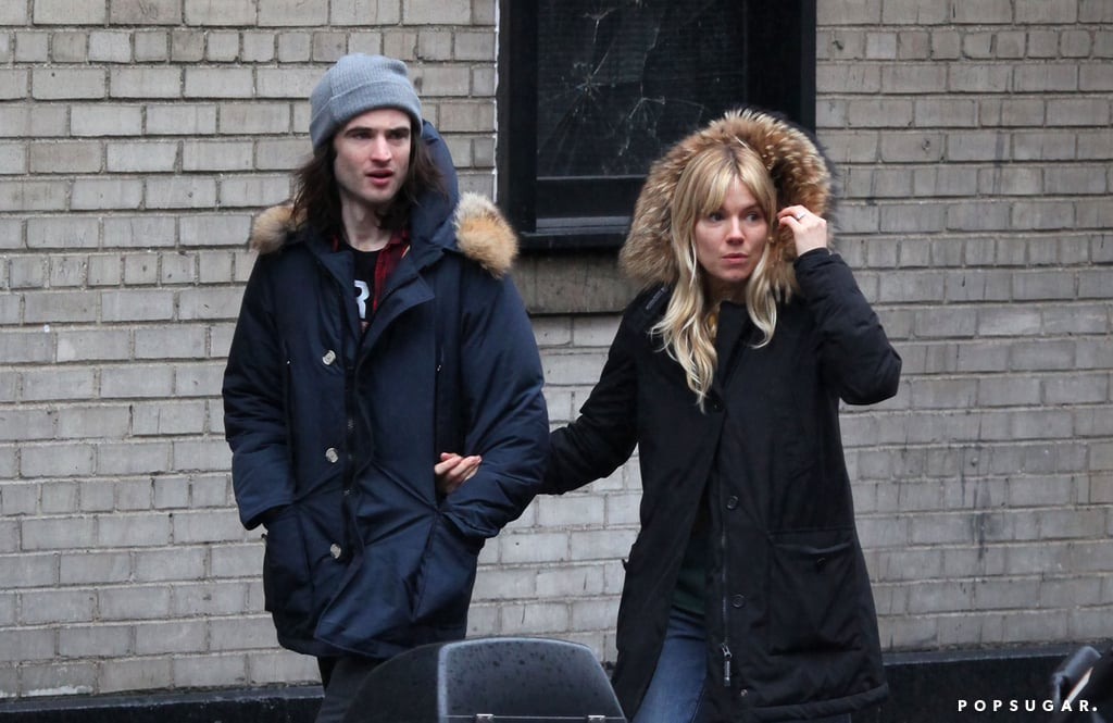Sienna Miller held onto Tom Sturridge in NYC.