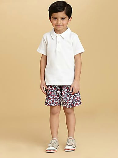 Traditionalists will embrace Oscar de la Renta's classic seashore print swim trunks ($50-$58, originally $95-$110) for little boys.