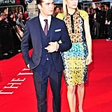 Zac Efron led costar Taylor Schilling into the premiere of The Lucky One in London.