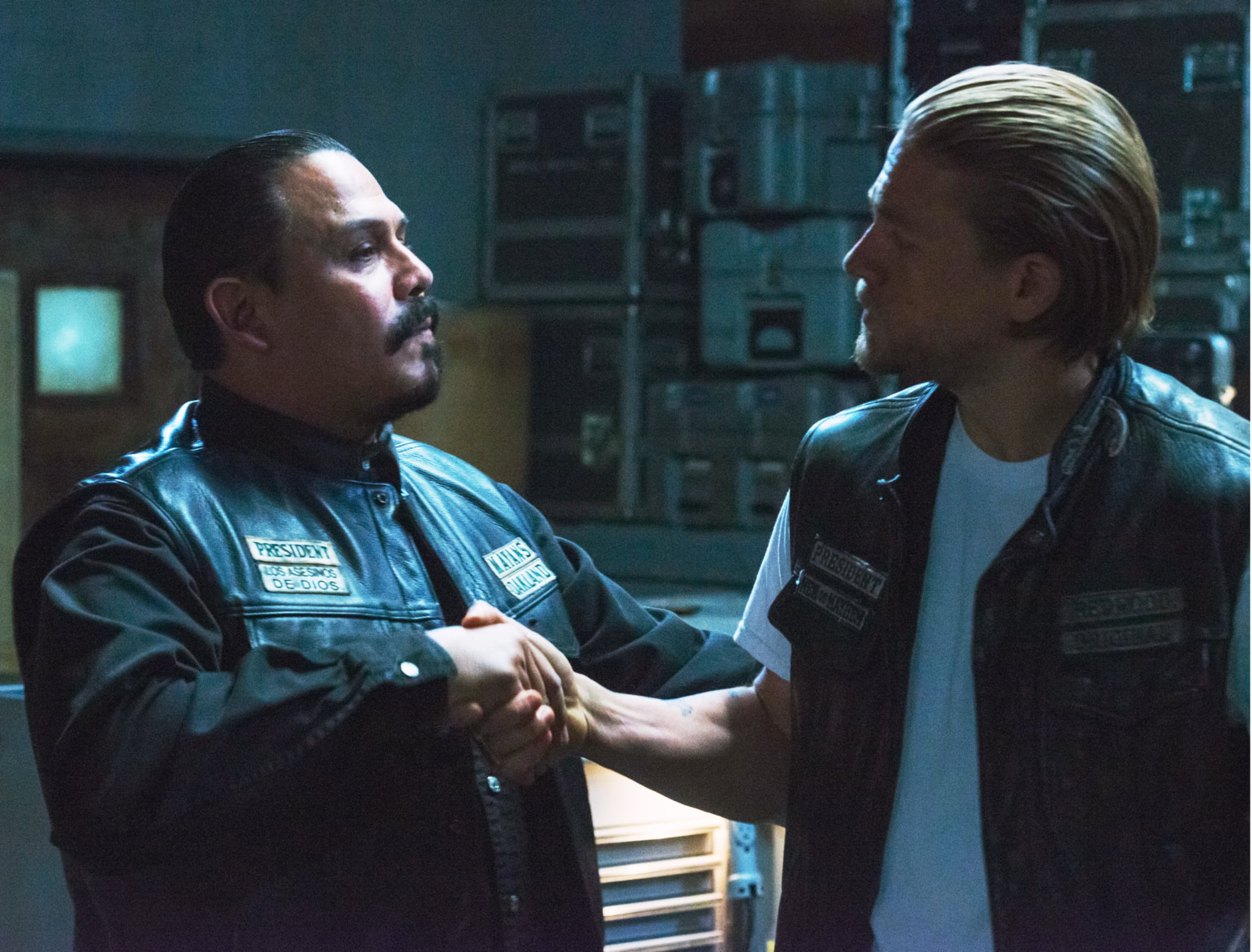 SONS OF ANARCHY, l-r: Emilio Rivera, Charlie Hunnam in 'Suits of Woe' (Season 7, Episode 11, aired November 18, 2014). ph: Prashant Gupta/FX/courtesy Everett Collection