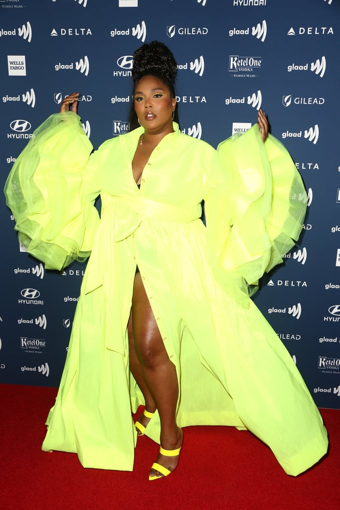 Lizzo wore a highlighter yellow coat dress with puffed bell sleeves and strappy heels to the 30th Annual GLAAD Media Awards.