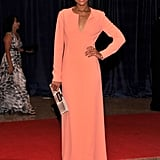 Kerry Washington posed on the red carpet in a long coral gown.