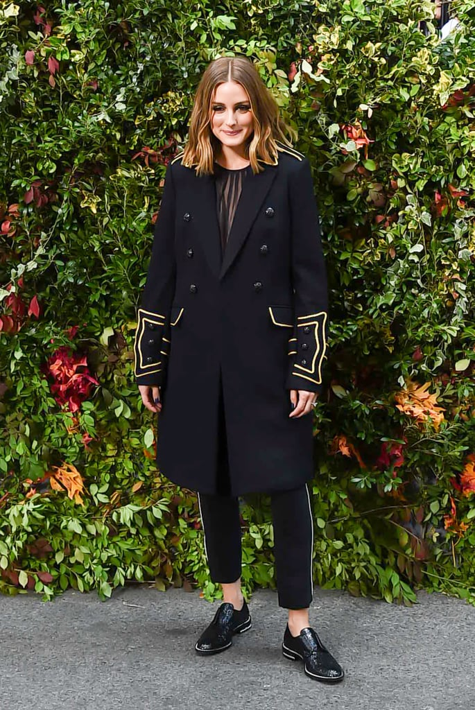 Olivia arrived to show her own collaboration for Banana Republic in a military-inspired look plucked straight from the collection.