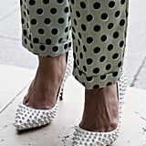 Spiked pumps and polka-dot pants lent textural intrigue to this Fashion Week look.