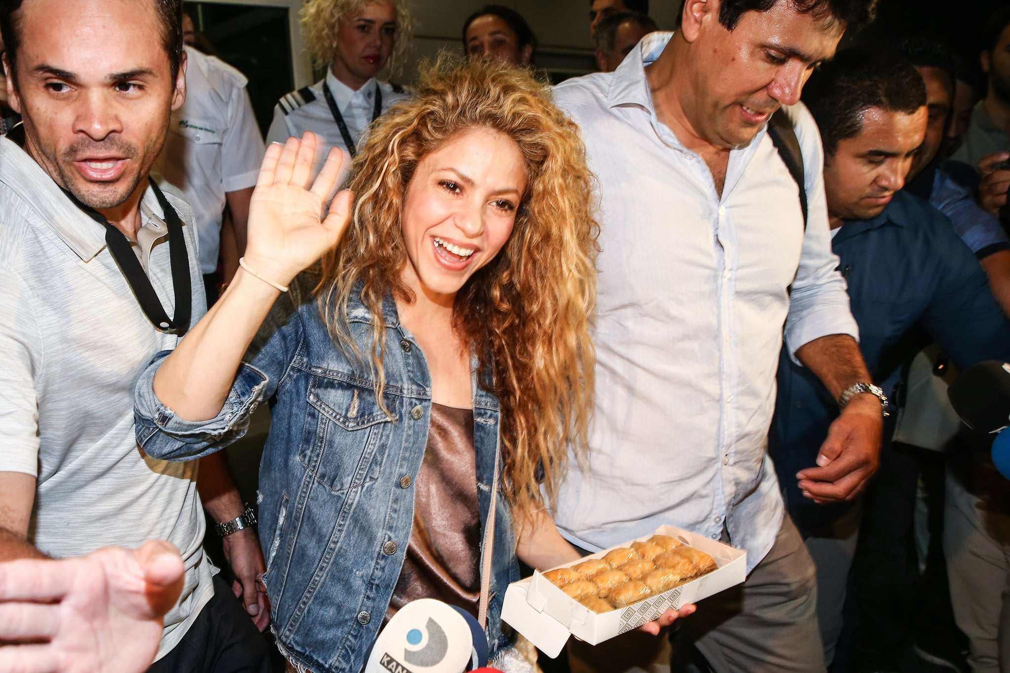 ISTANBUL, TURKEY - JULY 10: Columbian pop star Shakira holds baklava, offered by press members, as she arrives for a concert in Istanbul, Turkey on July 10, 2018. Grammy award-winning singer will perform at Vodafone Park on July 11 as part of her 6th world tour 'El Dorado'. (Photo by Onur Coban/Anadolu Agency/Getty Images)