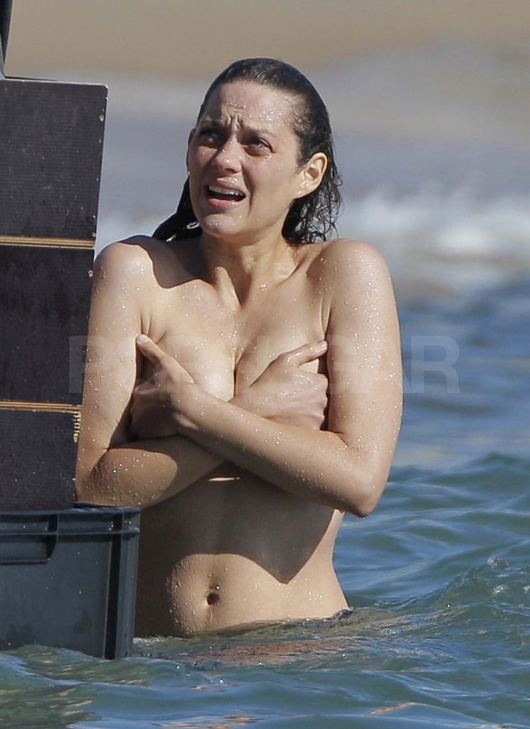 Marion Cotillard took off her t-shirt on the set of Rust and Bone in France today. She went topless to film a scene in the water with her costar Matthias Schoenaerts after the duo prepped on the beach. Marion arrived in the South of France last week and she brought her son, Marcel, along to the location. The 4-month-old stayed behind for a recent day of prep in Antibes, though, where Marion practiced her killer-whale training skills at Marineland. Her son has been traveling with her since his birth in May, and they've stopped in LA and NYC as well as in Marion's hometown of Paris.