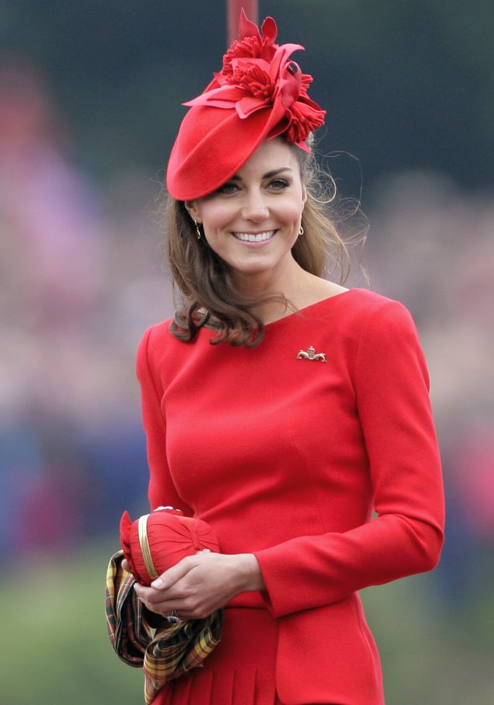 Kate in scarlet Sylvia Fletcher for Lock and Co. at the Diamond Jubilee River Pageant in 2012.