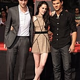 Kristen Stewart stood back to take in her cement plaque at Grauman's Chinese Theater with Robert Pattinson and Taylor Lautner