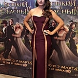Mila Kunis walked the carpet at the Moscow premiere of Oz the Great and Powerful in a curve-hugging Atelier Versace gown and the bombshell waves to match.