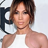 At the premiere of Parker, Jennifer went with an updo that let her long parted bangs take center stage. She paired the look with a neutral makeup palette, including her signature nude lips.