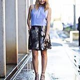 The pastel top kept this shimmering skirt more daytime-appropriate, while lace-up heels added edge. Source: Le 21ème   Adam Katz Sinding