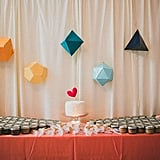 If you plan on having a homemade cake, allow its simplicity to stand out against a brightly colored geometric backdrop.  Photo by  Studio Castillero via Green Wedding Shoes