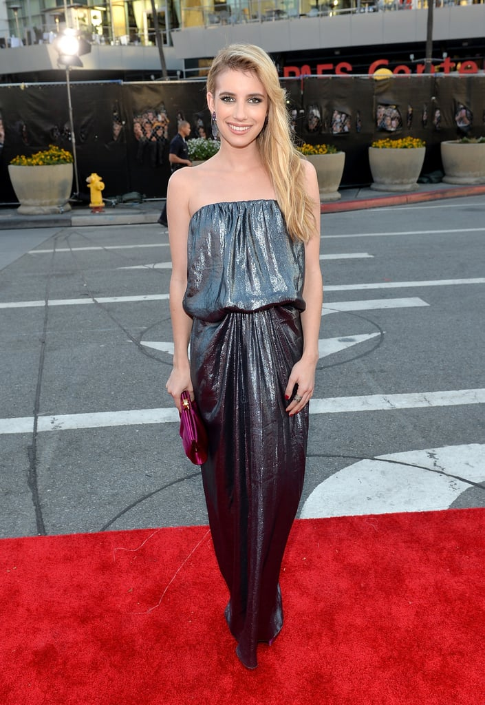 Emma Roberts let her shimmering silver Lanvin gown do all the talking, accessorizing with a satin fuchsia Rodo clutch, Casadei pumps, and sideswept blond locks.