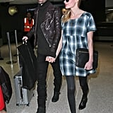 Kate Bosworth held fiancé Michael Polish's hand as the couple arrived at LAX.
