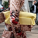 The bag matched the whimsical suiting in this mix. Source: Greg Kessler