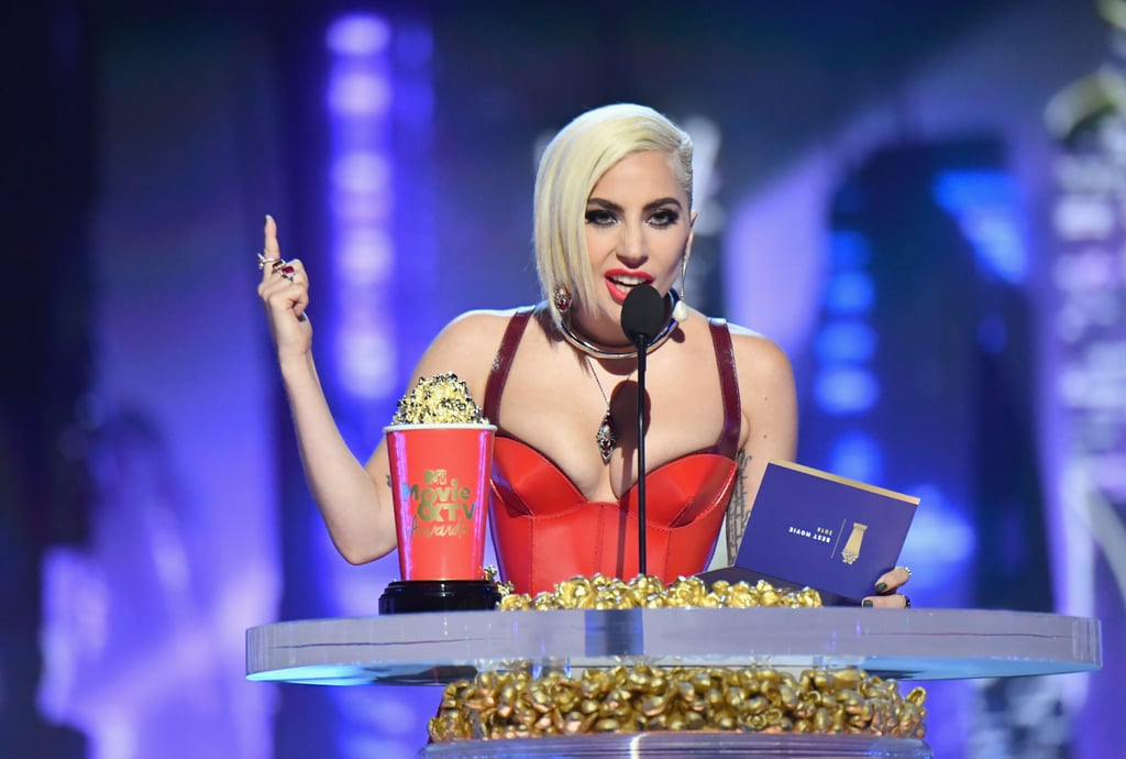 "Lady Gaga always knows how to spoil her ""Little Monsters,"" and her surprise appearance at the 2018 MTV Movie & TV Awards was no exception! When the multihyphenate performer arrived to accept the award for best music documentary (for Netflix original Gaga: Five Foot Two), fans went wild . . . and when she switched gears to present the award for best movie, they couldn't contain themselves.  Ahead, watch Gaga's surprise appearance to accept her award. Then, watch her present ""Black Muthaf*ckin' Panther"" with the night's highest honors! Peep photos of her entire night, and if that's still not enough, you can check out both Michael ""Bae"" Jordan and Chadwick Boseman as they deliver memorable speeches while accepting their own awards for Black Panther."