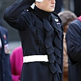 Prince Harry slipped into his uniform for a visit to Westminster Abbey's Field of Remembrance on Thursday in London.