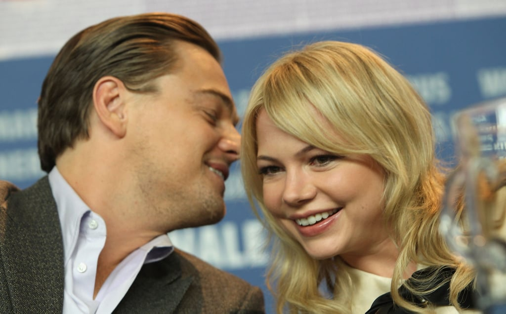 Leo laughed with Michelle Williams at a press conference for Shutter Island in February 2010.