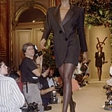 A slick black tuxedo suit dress took center stage at his Fall 1988 haute couture show.
