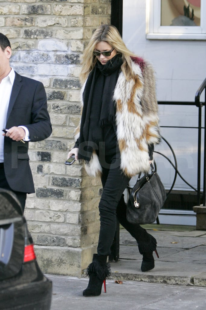 Kate Moss wrapped up in her Isabel Marant fur jacket today when she left her London home. She's home in the UK with her husband Jamie Hince following a November getaway to Paris. The excursion was so that Kate could see Jamie while he was on tour with the Kills, but she's had her own work associations with France lately. Kate Moss covers the new Vogue Paris, though with a very different look —photographers Mert Alas and Marcus Piggott captured Kate in a full David Bowie disguise. Kate also channeled the rock star in 2003 in shoot for British Vogue. She's fresh off a fashionable week in the UK, having attended Tuesday's British Style Awards. She didn't take home a statue that evening, but she's in the running for a different prize. If you think Kate is the top model of 2011, make sure to show her some love in our poll!