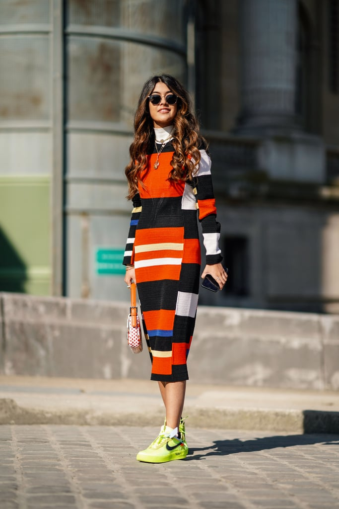 Mix brights and contrast a colorblock dress with high-octane sneakers.