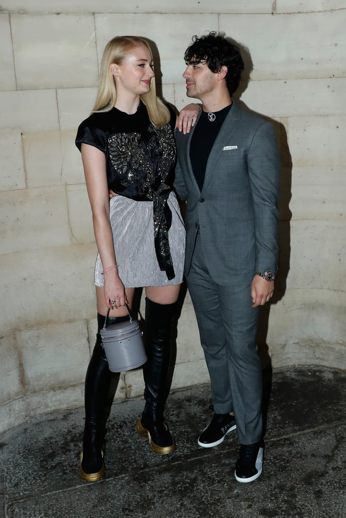 """Ah, Paris — the City of Love, high fashion, and cute Joe Jonas and Sophie Turner pictures. The two lovebirds were in the city for Paris Fashion Week and made an appearance at the Louis Vuitton show. This marked the first red carpet event that they've attended as a couple. When they arrived, they posed with each other and also got a few snaps with Louis Vuitton's creative director, Nicolas Ghesquière.  At the end of the night, Joe and Sophie also had a romantic dinner and shared a cute photo of them showing a little bit of PDA. """"With my love in Paris,"""" Sophie captioned her photo. Joe posted the same photo, accompanied by the red heart and flag of France emojis. See more pictures of them enjoying time together at the show in the photos ahead."""