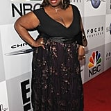 Retta arrived in a black number.