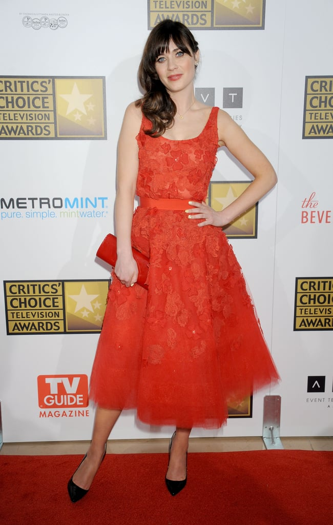 Never one to shy away from a ladylike silhouette, Zooey wore a red embellished Oscar de la Renta dress to the Critics' Choice Television Awards in June.