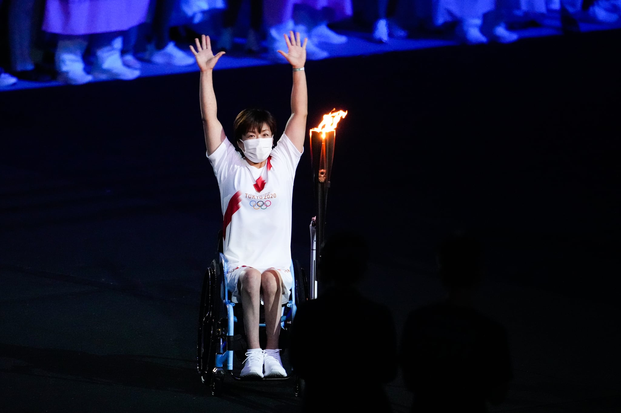 TOKYO, JAPAN - JULY 23: Paralympic athlete Wakako Tsuchida carries the Olympic torch during the Opening Ceremony of the Tokyo 2020 Olympic Games at Olympic Stadium on July 23, 2021 in Tokyo, Japan. (Photo by Wei Zheng/CHINASPORTS/VCG via Getty Images)