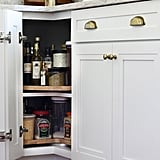 Placing lazy Susans in kitchen cabinets makes it easy to pack and access smaller cooking items.