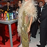 Heidi Klum wrapped herself in a feather boa at Elton John's Oscar party.