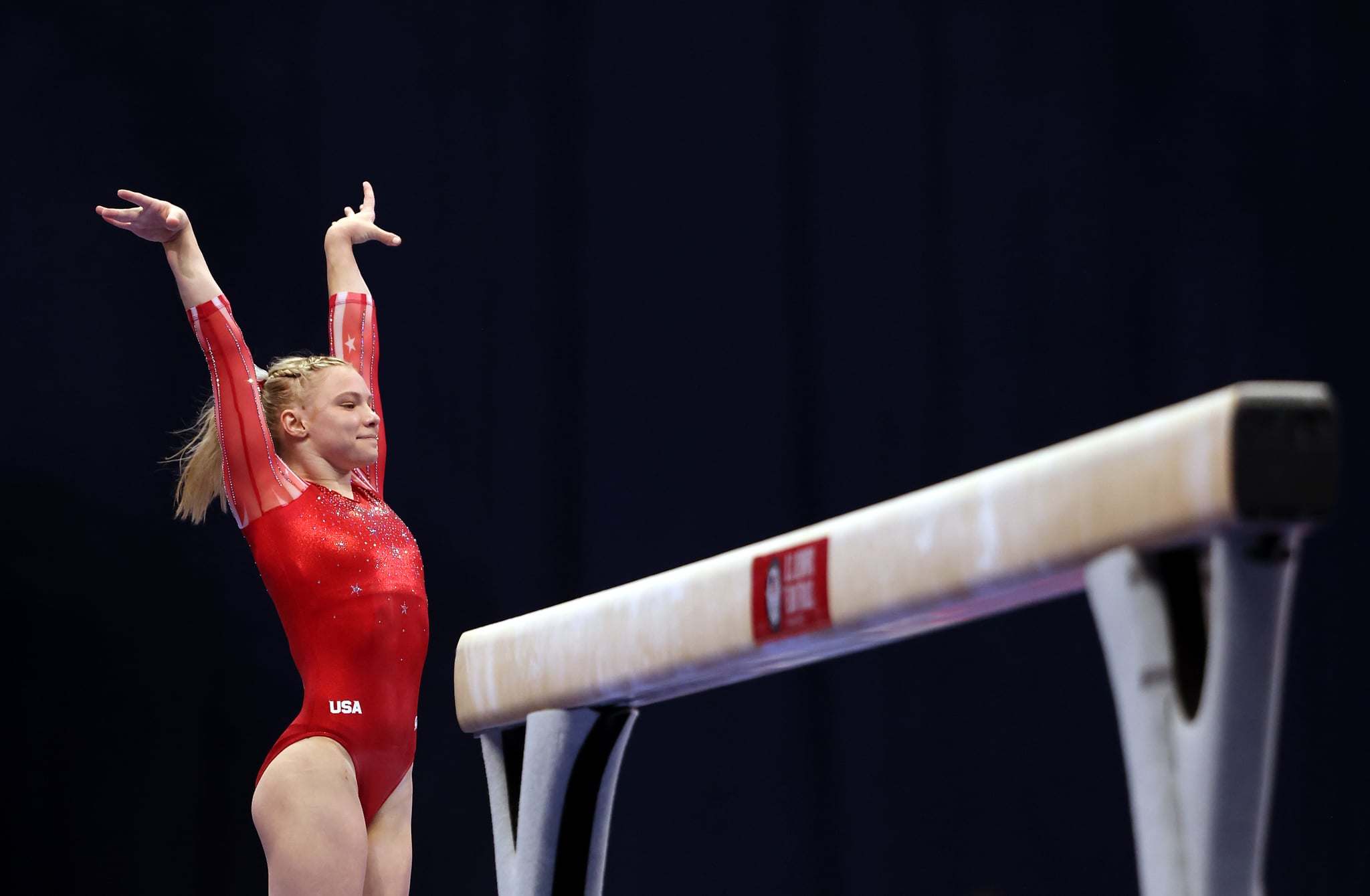 ST LOUIS, MISSOURI - JUNE 25:  Jade Carey smiles after landing her dismount off the balance beam during the Women's competition of the 2021 U.S. Gymnastics Olympic Trials at America's Center on June 25, 2021 in St Louis, Missouri. (Photo by Jamie Squire/Getty Images)