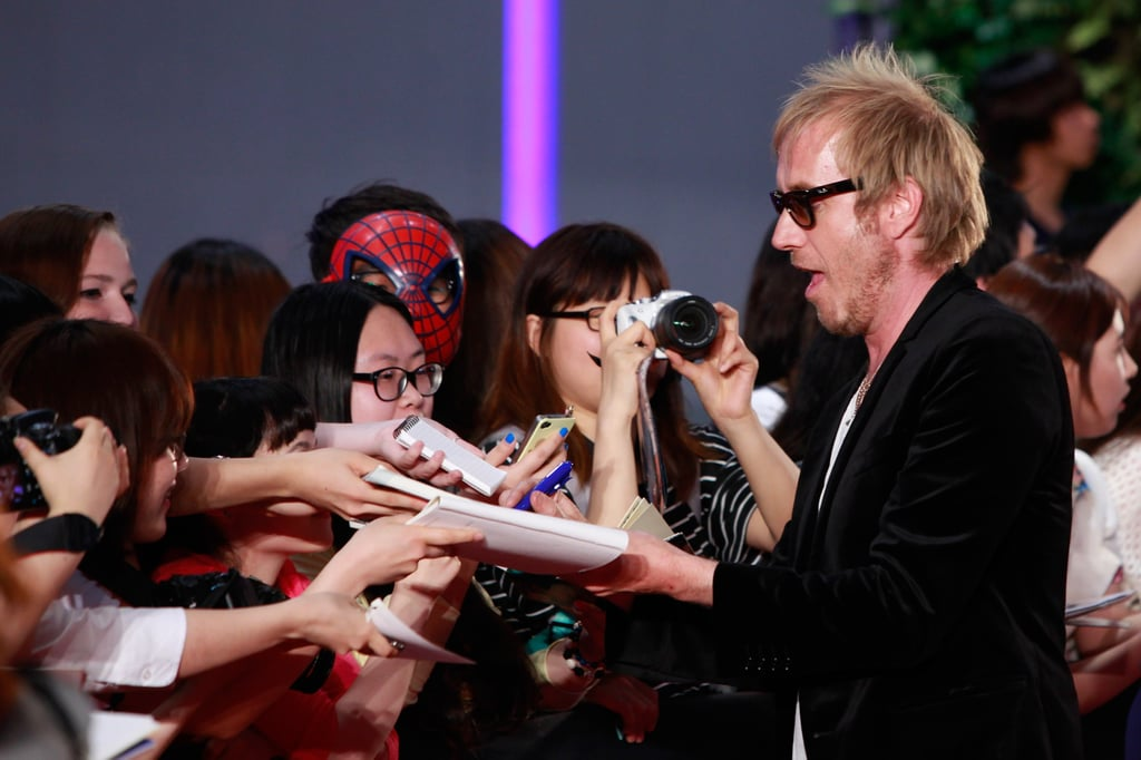 Rhys Ifans signed autographs for fans.