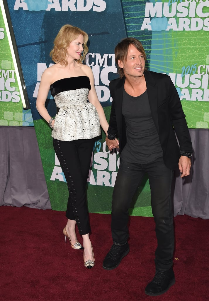 Nicole and Keith kept close and held hands on the red carpet of the 2015 Country Music Awards.
