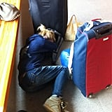 Brooklyn Decker curled up in the airport during a flight delay. Source: Twitter user BrooklynDecker