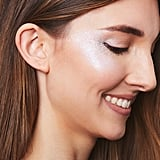 "If you're concerned about locking down your glitter — as we all know, this beauty accessory tends to migrate! — Rabanal advises that you keep your skin a little moist to help the sparkles stick. ""Don't powder over everything too much,"" he warned. ""Prep + Prime Fix+ Spray ($32) helps to re-add moisture."" Try spritzing it onto your brush to help apply the glitter."
