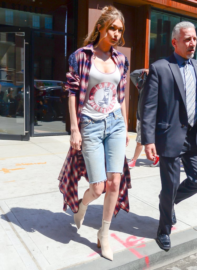 Gigi Styled Her Beige Sock Boots With a Long Tartan Shirt, Tank Top, and Bermuda Shorts