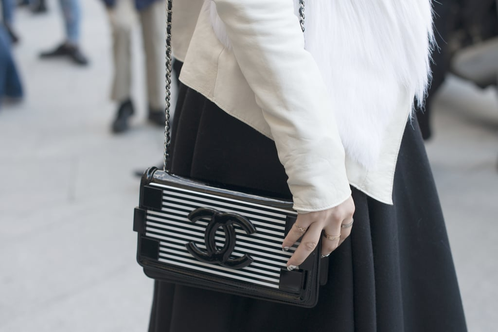 She stayed color coordinated with a black and white Chanel Lego clutch.
