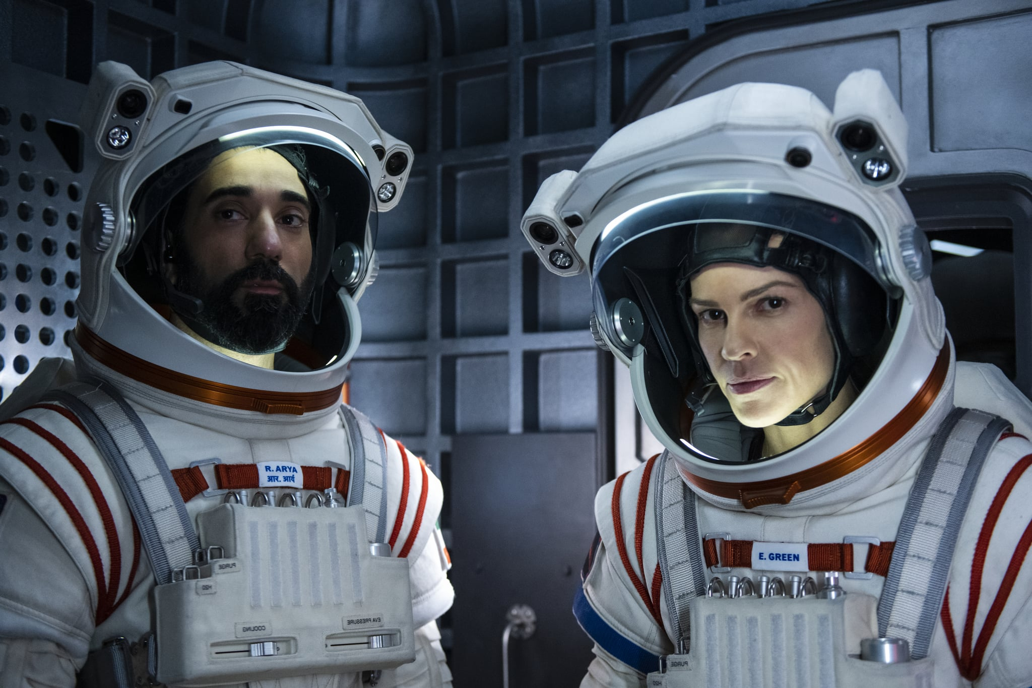 AWAY (L to R) RAY PANTHAKI as RAM ARYA and HILARY SWANK as EMMA GREEN, in episode 109 of AWAY. Cr. DIYAH PERA/NETFLIX  2020