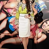 For the Madrid photocall for Spring Breakers, Selena Gomez tucked a neon floral blouse into a white pencil skirt, then finished off with classic black Casadei pumps.