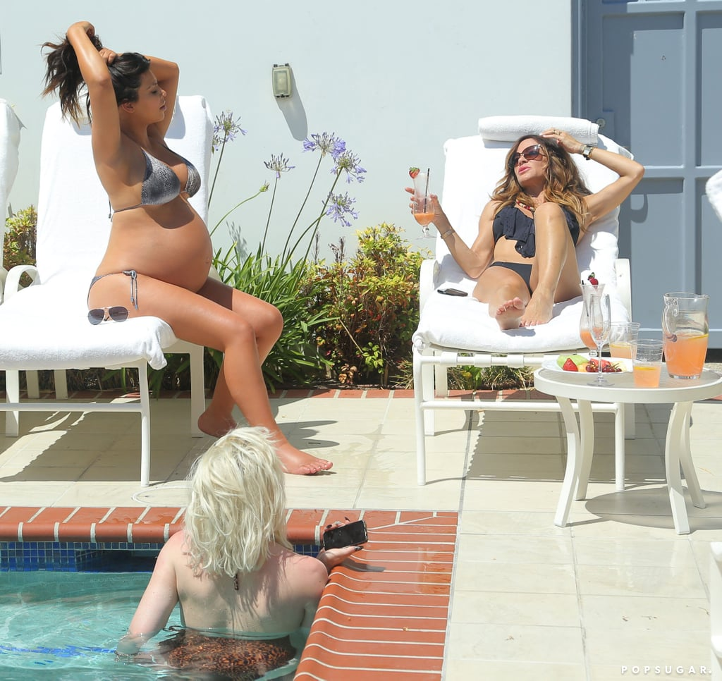 Kim Kardashian hung out with friends poolside before giving birth in June.
