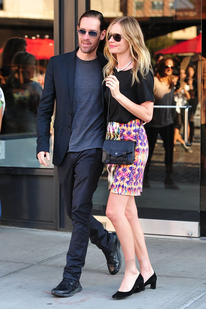 Kate balanced her high-wattage skirt with a black tee, kitten heels, and a Proenza Schouler crossbody while shopping with fiancé Michael Polish in New York.