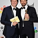 Hugh Jackman and Tom Hooper smiled with Hugh's award.