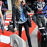 Cara Delevingne doesn't seem to follow any style rules, but it all works. Here's the loophole: she stays covered up, adds interest with pops of color, layers up with cool leather pieces, and finishes with great accessories like a Saint Laurent bag.