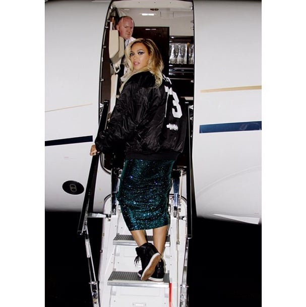 "Beyoncé traded her heels for sneakers when she hopped on a private plane while still wearing her glimmering Vrettos Vrettakos dress following her performance at the 2014 Brit Awards on Wednesday evening. The singer skipped the Brit Awards afterparty and, instead, shared snaps of her postperformance routine on Instagram and Facebook, including a sweet photo of her holding hands with husband Jay Z while backstage at the show and, after, boarding a plane in her dress while wearing a jacket from Jay-Z's tour. Interestingly enough, Jay's jackets have a fan in the fashion world as Tom Ford coped Jay's jackets for his Fall 2014 collection. (Bey's jacket reference's Jay Z's ""Picasso Baby"" song while, on the runway, Tom sent out jackets referencing Jay's ""Tom Ford"" jam, which said, ""I don't pop molly, I rock Tom Ford."") Now, the singer and her main man are on the move to Glasglow, Scotland, where she will continue her Mrs. Carter world tour. The Brit Awards marked Beyoncé's second award show appearance of the year, the first being her critically acclaimed return to the Grammys stage to sing ""Drunk in Love"" with Jay back in January. This time around, Beyoncé performed ""XO,"" making it the first time that she's sung the song in front of a live audience. Source: Instagram user beyonce"