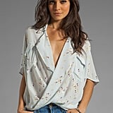 A little sexy and perfectly breezy with a sweet Spring hue — this Funktional Multi-Resolution blouse ($112) could easily become a favorite in our closet.