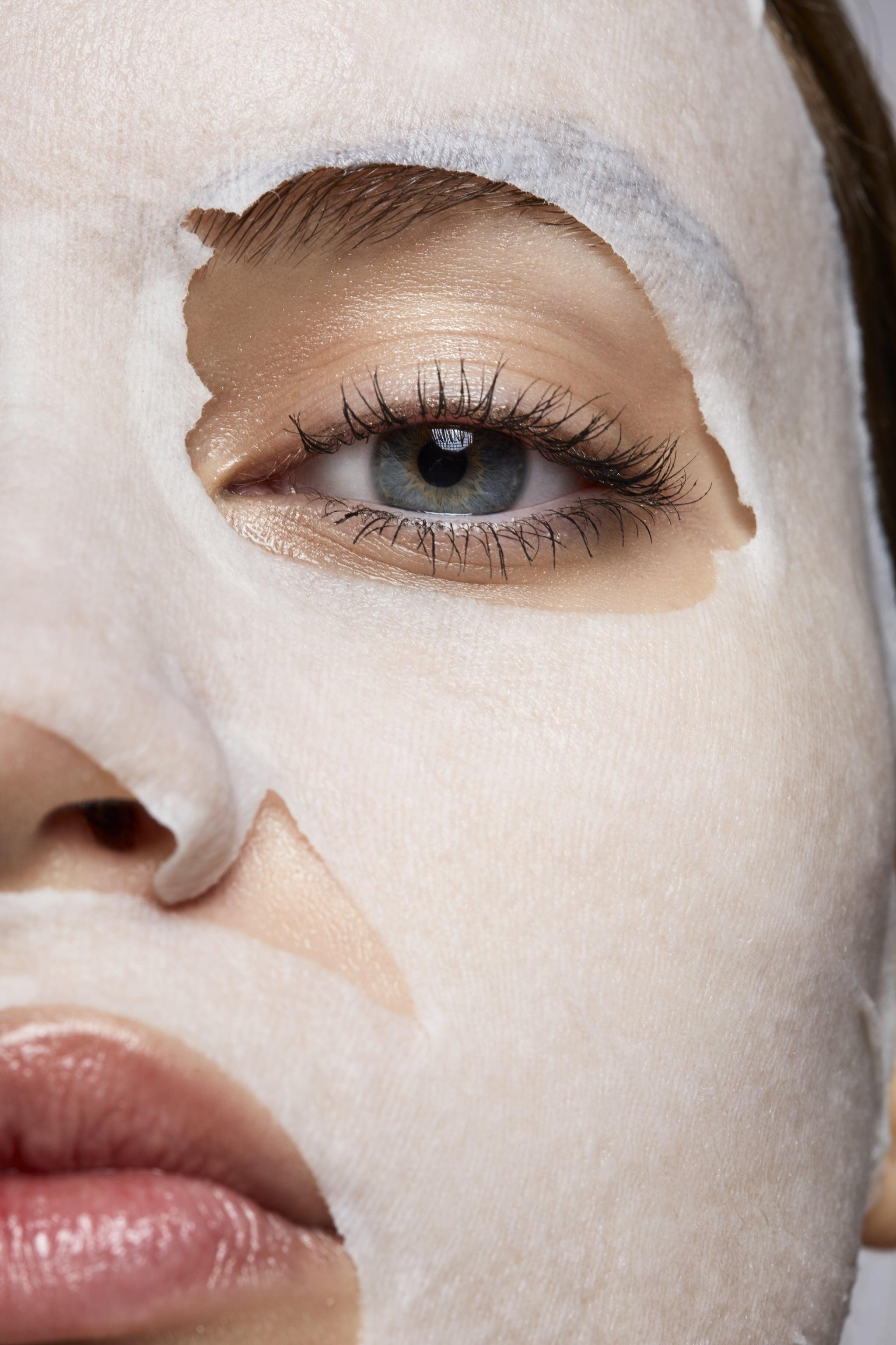 woman wearing a korean facial sheet mask